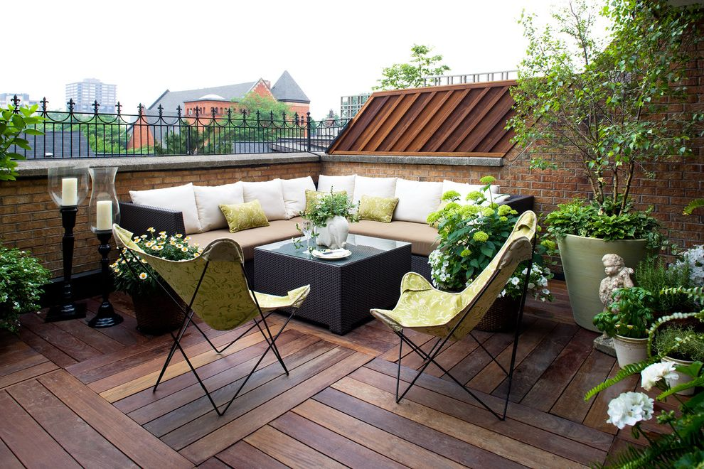 Folding Chairs with Cushions   Contemporary Balcony Also Balcony Brick Brick Railing Candlesticks Green Outdoor Sectional Pillows Potted Plants Seat Cushions Umbrella Chairs White Wood Deck Woven Outdoor Furniture