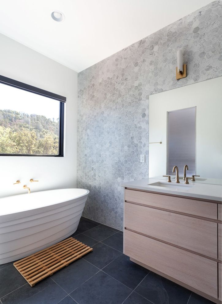 Foot Massage Sacramento   Contemporary Bathroom  and Black Brass Fixtures Contemporary Hexagon Wall Tile Modern Rectalinear Wall Sconces Walnut Warm White Window Over Tub Wood Bathmat