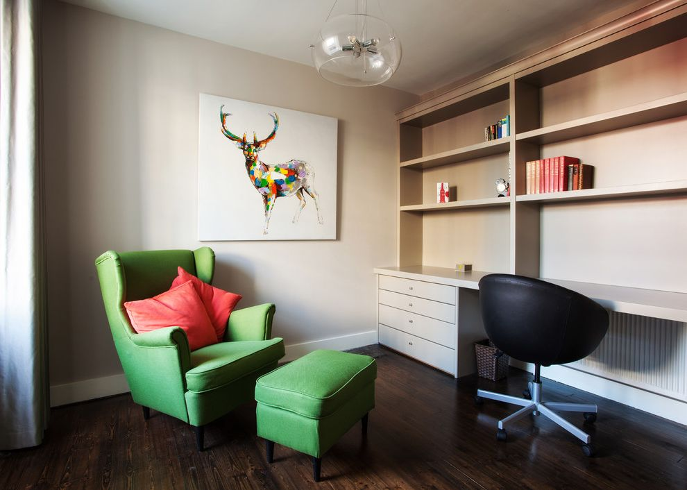 Footrest for Desk with Contemporary Home Office Also Armchair Baseboard Beige Walls Black Desk Chair Bookshelves Built in Desk Colorful Large Art Desk Green Wing Chair Office Painting Pendant Light Picture Red Pillows Studio Swivel Chair Wood Floor