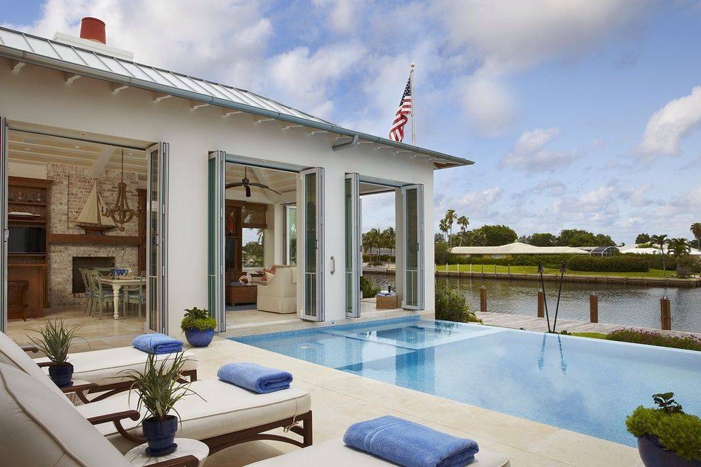 Fort Worth Pool Builders with Tropical Pool  and American Flag Bifold Doors Flag Pole Lounge Chairs Small Pool Water View