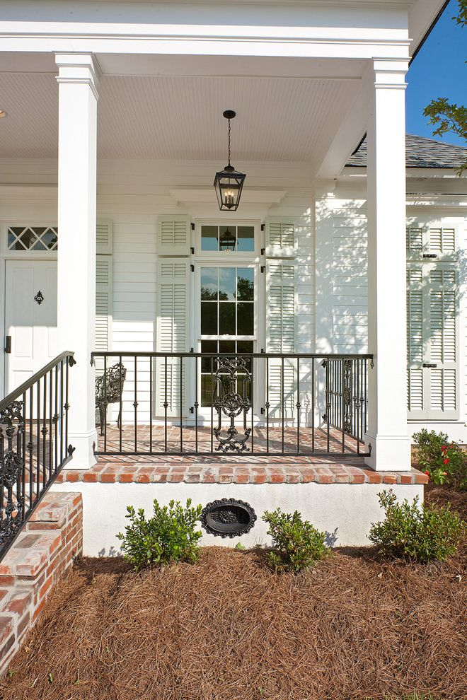 Foundation Vent Covers   Traditional Porch Also Brick Brick Porch Cottage Covered Porch French Window Front Entrance Front Entry Iron Railing Lantern Shutters Veranda