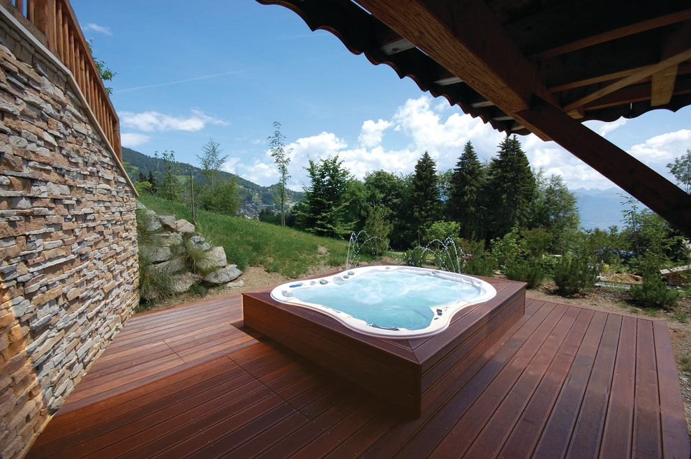 Four Person Hot Tub with Contemporary Deck and Backyard Deck Fountain Home Spa Hot Tub Hot Tubs Portable Hot Tub Relax Spa Stone Wall View