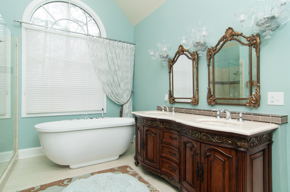 Frame Shops Durham Nc   Traditional Bathroom Also Arched Window Beige Floor Tile Cathedral Ceiling Framed Mirrors Two Sinks Wall Sconces White Countertop Widespread Faucet