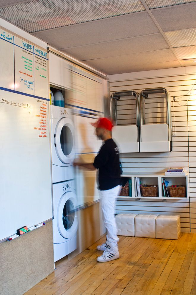 Framed Dry Erase Board with Contemporary Laundry Room  and Floating Shelves Laundry Small Stackable Washer and Dryer Stacked Washer and Dryer Storage Urban Washer Whiteboard Wood Floors