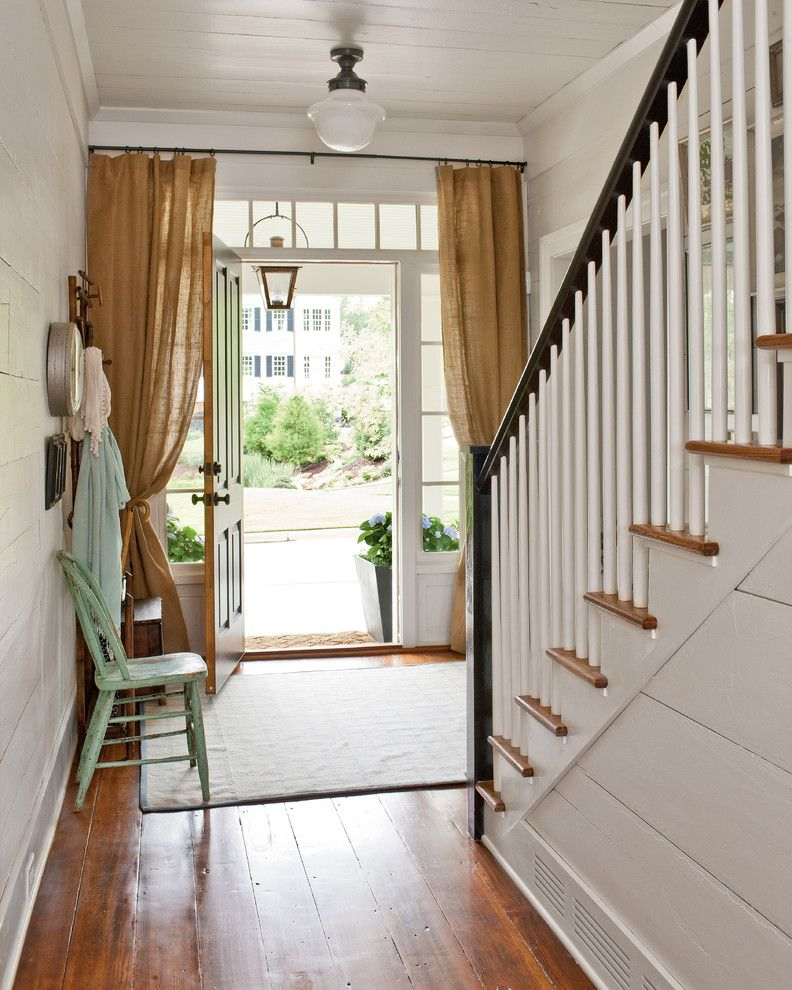 Front Door Curtain Panel   Farmhouse Entry  and Burlap Curtains Ceiling Light Distressed Paint Entry Hall Farmhouse Potted Plants Renovation Staircase Stairhall Transom Window White Walls Wood Ceiling Wood Floor Wood Paneling Wood Treads Woven Area Rug