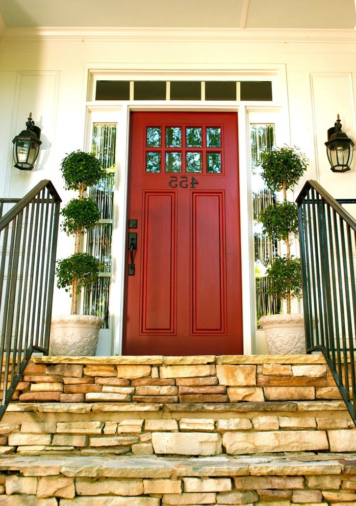 Front Door Curtain Panel   Traditional Entry Also Front Door Front Entrance House Number Iron Railing Numbers on Door Outdoor Lantern Lighting Potted Plants Red Front Door Stone Patio Stone Steps Topiaries Wrought Iron Hardware