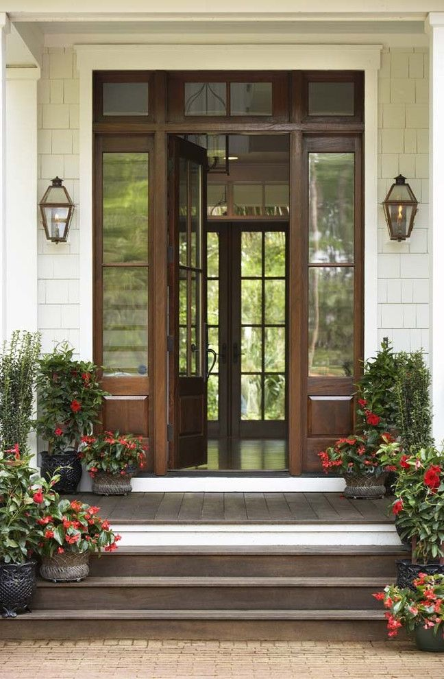 Front Door Window Treatments   Traditional Entry  and Container Plants Door Casing Front Porch Front Stoop Glass and Wood Front Door Lanterns Potted Plants Red Flowers Shingle Siding Sidelights Symmetry Transom