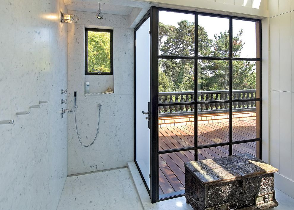 Frosted Glass Exterior Door with Contemporary Bathroom  and Alcove Balusters Black Framed Windows Carrara Marble Carved Wood Trunk Marble Walls Towel Hooks Wall Sconce White Painted Wood Walls Window Wood Deck