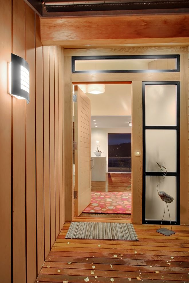 Frosted Glass Exterior Door with Contemporary Entry  and Deck Door Mat Exposed Beams Front Door Outdoor Lighting Sconce Sculptures Sidelights Statues Transom Wall Lighting Wood Flooring