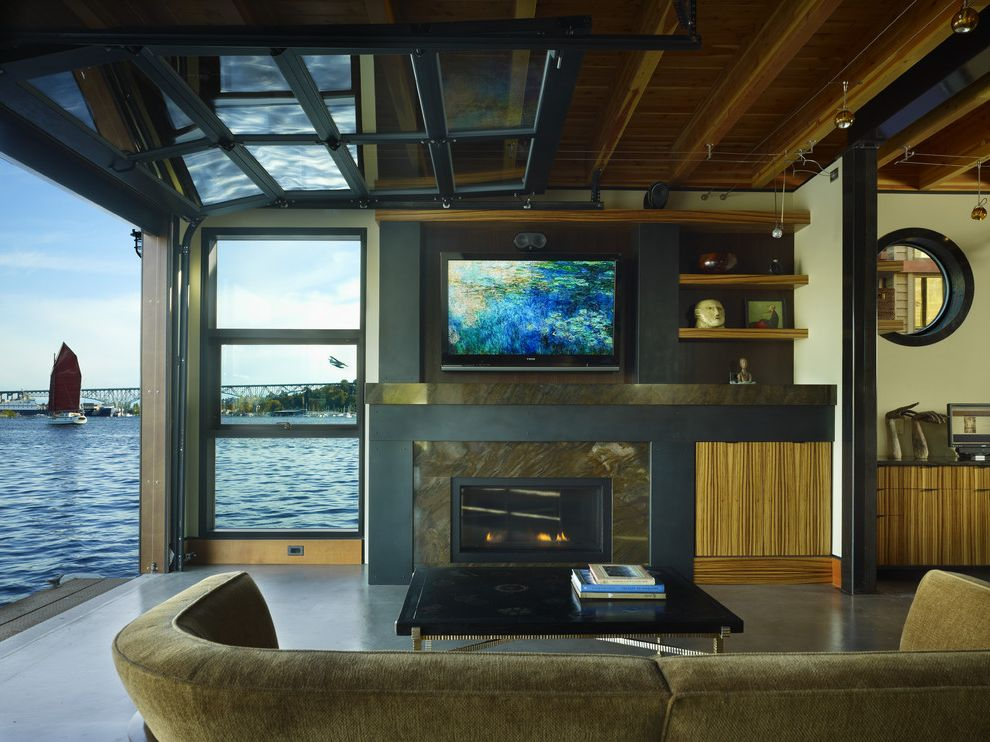 Frosted Glass Garage Door with Contemporary Living Room Also Curved Sofa Exposed Beams Floating House Houseboat Neutral Colors Porthole Roll Up Garage Door Tv Above Fireplace View Wall Mount Tv Waterfront Wood Ceiling Wood Paneling