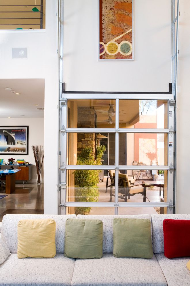 Frosted Glass Garage Door with Contemporary Patio  and Artwork Clear Garage Door Colorful Pillows Garage Door Great Room High Ceilings Open Floor Plan Tall Ceilings White Walls