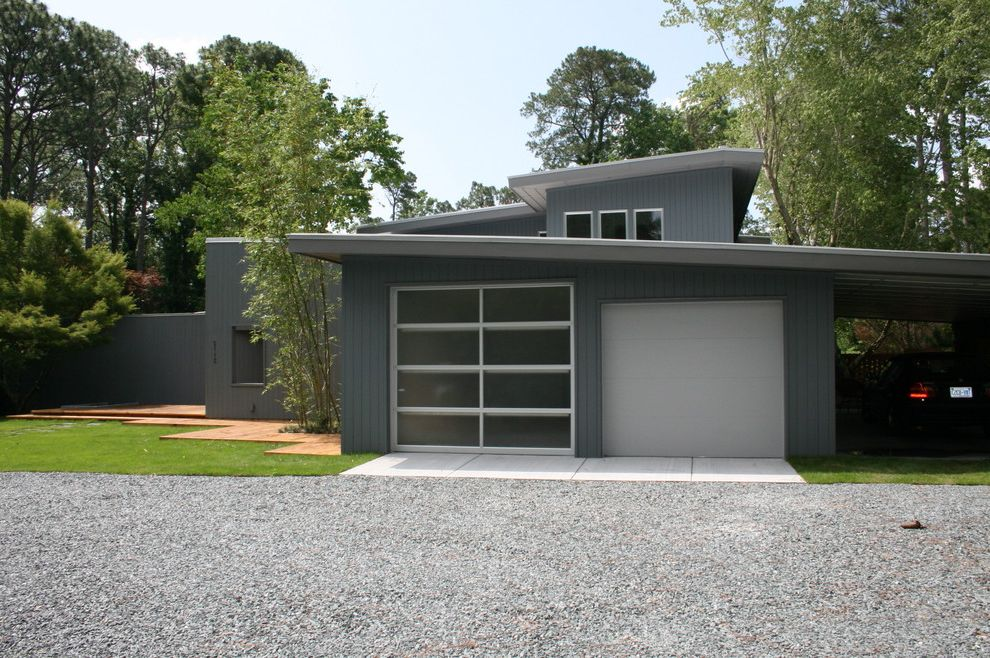 Frosted Glass Garage Door with Modern Garage  and Carport Gravel Gray Lawn Slanted Roof Vertical Siding