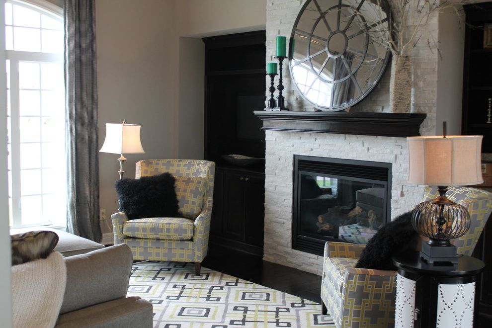 Furniture on Consignment Wichita Ks   Transitional Living Room  and Dark Wood Mantel Iron Base Lamp Mongolian Wool Pillows Patterned Chairs Patterned Rug Round Mirror Silver Floor Lamp Stone Fireplace Studded End Table Transitional