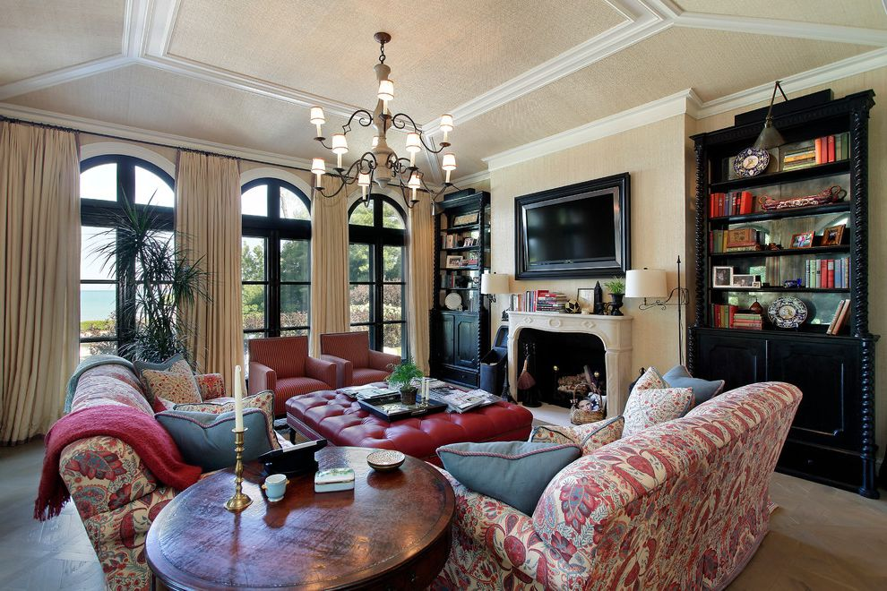 Furniture Stores Baton Rouge   Mediterranean Family Room  and Arch Beige Drapes Built in Shelves Ceiling Trim Family Room Fireplace Grasscloth Iron Chandelier Mantel Printed Sofa Red Red Leather Ottoman Round Side Table Transitional Tv Over Fireplace