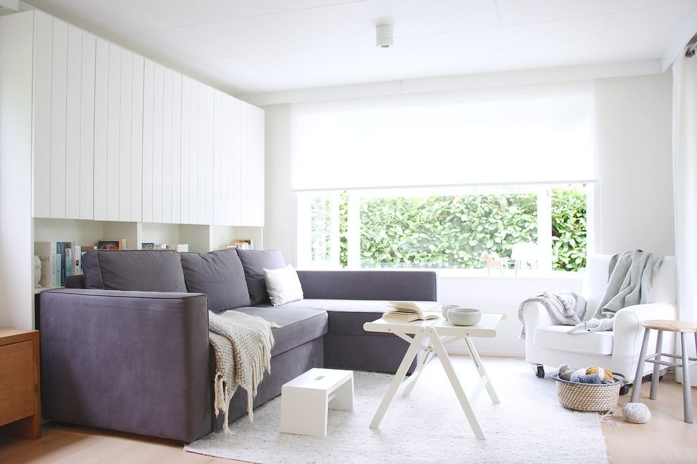 Furniture Stores in Des Moines   Scandinavian Living Room  and Dark Gray Sectional Sofa Folding Coffee Table Large Window Light Gray Rug My Houzz Natural Lighting Small Stool White Armchair White Footstool White Shade White Walls White Window Treatment