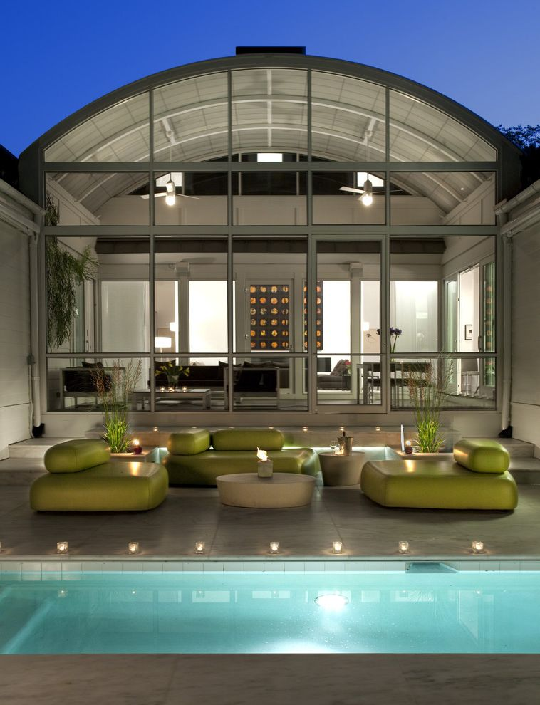 Furniture Stores in Des Moines   Transitional Pool  and Accent Colors Curved Roof Glass Wall Lounge Furniture Neon Green Outdoor Lighting Patio Furniture Pool Pool Lighting Roof Line Sunroom Tea Lights