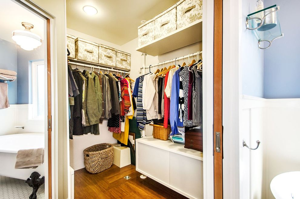 Furniture Stores in Des Moines with Traditional Closet  and Ceiling Lighting Corner Closet Pocket Doors Storage Boxes Wainscoting Walk in Closet Wood Flooring