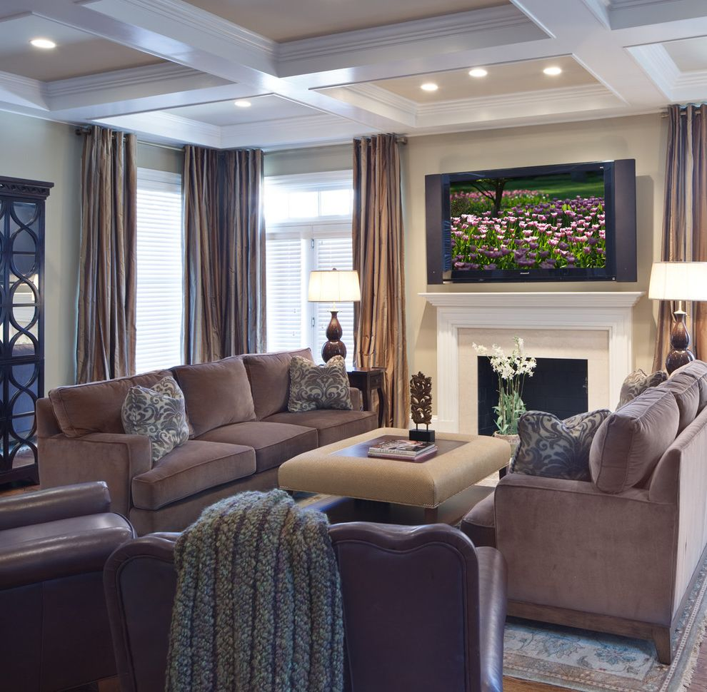 Furniture Stores in Maine with Contemporary Living Room  and Area Rug Browm Leather Arm Chairs Coffee Table Coffered Ceiling Fireplace Mirrored Armoire Pillows Sofa Tv White Painted Mantle Wood Floor