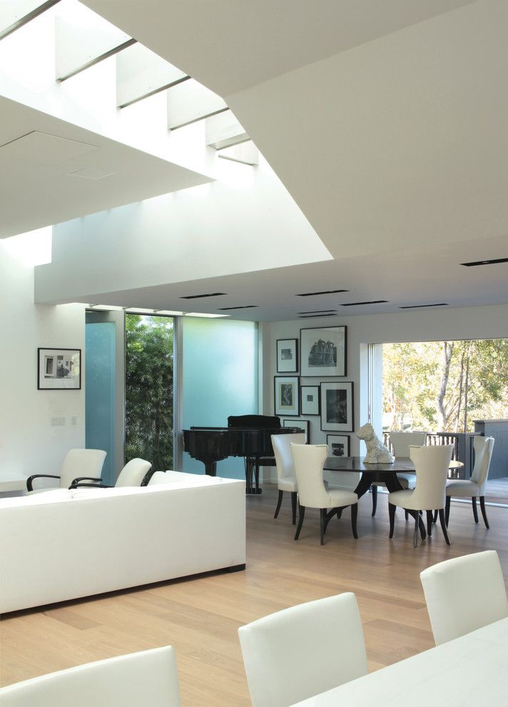 Furniture Stores in Santa Monica with Modern Dining Room  and Aluminum Windows Dining Room Dining Table Frosted Glass Door Fumed Wood Floor Round Table Skylight Sliding Doors