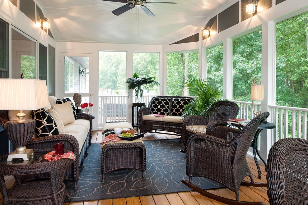 Furniture Stores in Savannah with Traditional Porch  and Area Rug Ceiling Fan Geometric Pillows Railing Rocking Chairs Sun Room Table Lamps White Seat Cushions Wood Floor Woven Outdoor Furniture Woven Side Tables