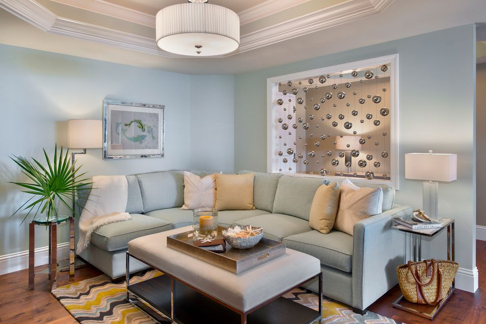 Furniture Stores Naples Fl   Transitional Living Room Also Beveled Ceilings Blue Sectional Colorful Rug Drum Ceiling Light Mirror Furniture Neutral Pillows Ottoman Coffee Table Pale Blue Couch Silver Floor Lamp Silver Side Table White Throw Blanket