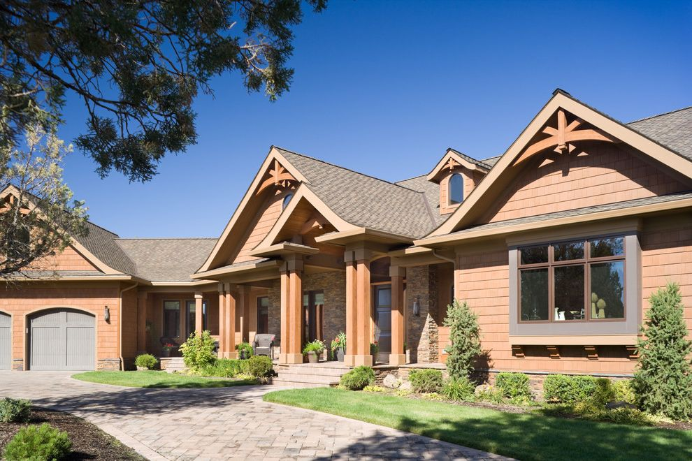 Gable End Vents with Rustic Exterior  and Brick Paving Cabin Dormer Windows Entrance Entry Front Door Front Porch Gable Roof Garage Doors Grass Lawn Path Rustic Shingle Siding Turf Walkway Wood Siding