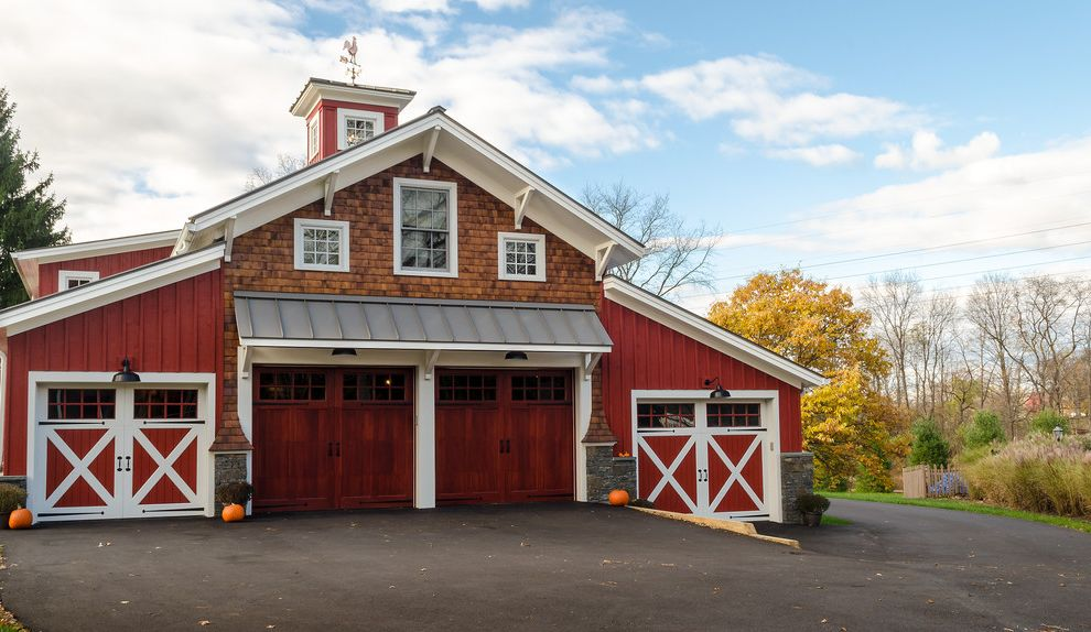 Garage Door Repair Fayetteville Nc with Farmhouse Exterior  and Antiqued Fixtures Board and Batten Cedar Shake Cupola Dark Cherry Eaves Garage Metal Roofing Pumpkins Roof Brackets Stained Garage Doors Stone Walls White Trim