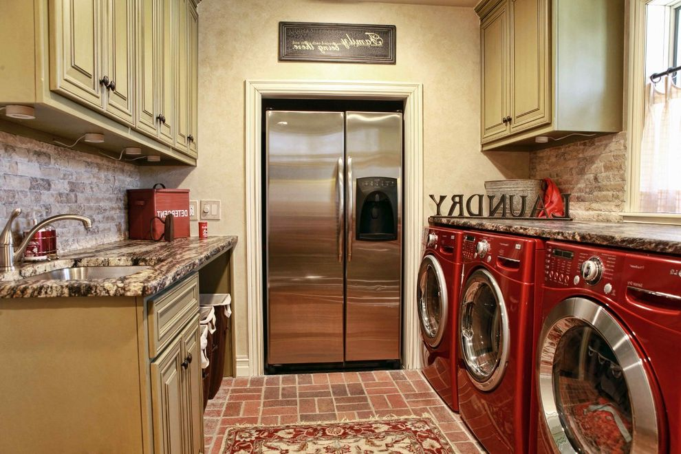 Garage Ready Refrigerator with Traditional Laundry Room  and Brick Floor Exotic Granite Countertops Painted and Van Dyke Brown Glazed Cabine Red Appliances Red Rug Rustic Cabinets Split Face Backsplash Tile Stainless Steel White Trim
