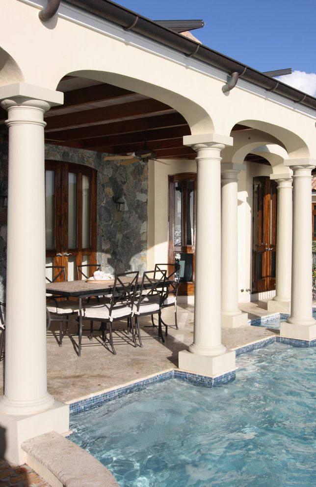 Gardner Pool Plastering   Tropical Porch Also Arced Wall Arch Dining Area Iron Chair Iron Table Modern and Zen Pedestal Pool Stone Floor Stone Wall Tiled Pool Wood Wood Trim