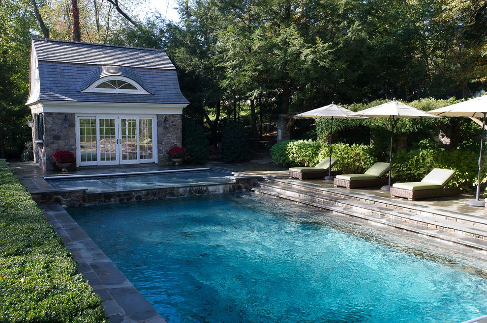 Gardner Pool Plastering with Traditional Pool Also Barn Roof Concrete Deck Eyebrow Dormer Hedge Landscaping Lawn Loungers Pool House Shingle Roof Steps Stone Facade Umbrellas White Painted Trim