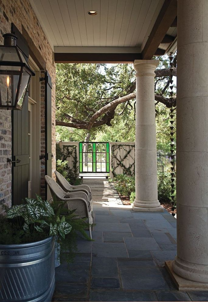 Gas Porch Light with Eclectic Porch Also a Hays Town Brick Exterior Columns Iron Gate Outdoor Lighting Pennsylvania Blue Stone Potted Plant Stained Glass Gate Stone Columns Stone Patio Wall Lanterns Wicker Chairs