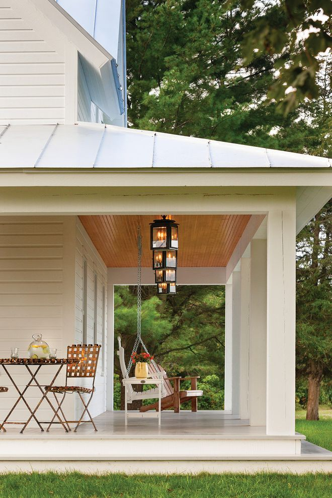 Gas Porch Light with Farmhouse Porch Also Farmhouse Porch Folding Chair Folding Table Lemonade Metal Roof Painted Wood Floor Porch Lighting Porch Steps Porch Swing White House Wood Ceiling Wraparound Porch