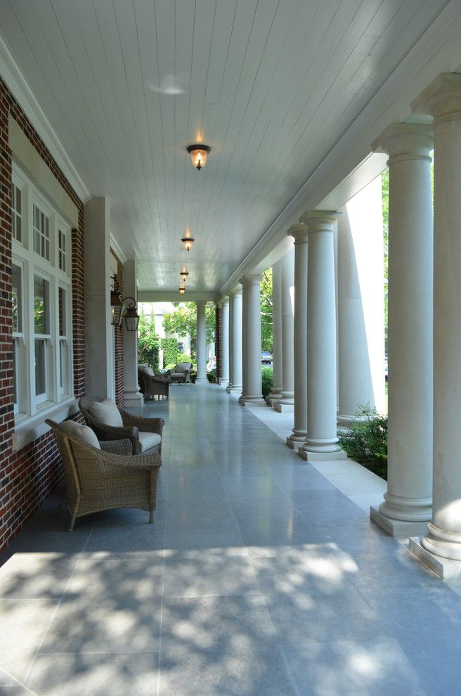 Gas Porch Light with Traditional Porch Also Brick House Brick Walls Ceiling Lighting Columns Lanterns Outdoor Lighting Patio Furniture White Trim Wicker Furniture Wood Ceiling Wraparound Porch