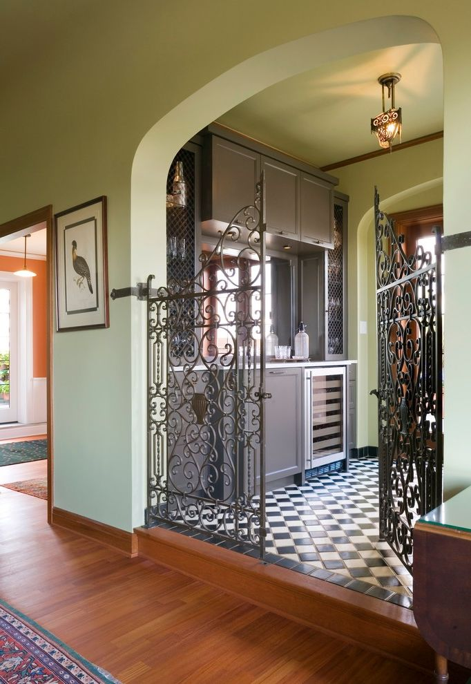 Gate Repair Brooklyn with Traditional Home Bar Also Arched Wall Opening Area Rug Beverage Cooler Ceiling Light Checkerboard Floor Home Bar Iron Gates Light Green Scrollwork Step Wood Casing Wood Floor