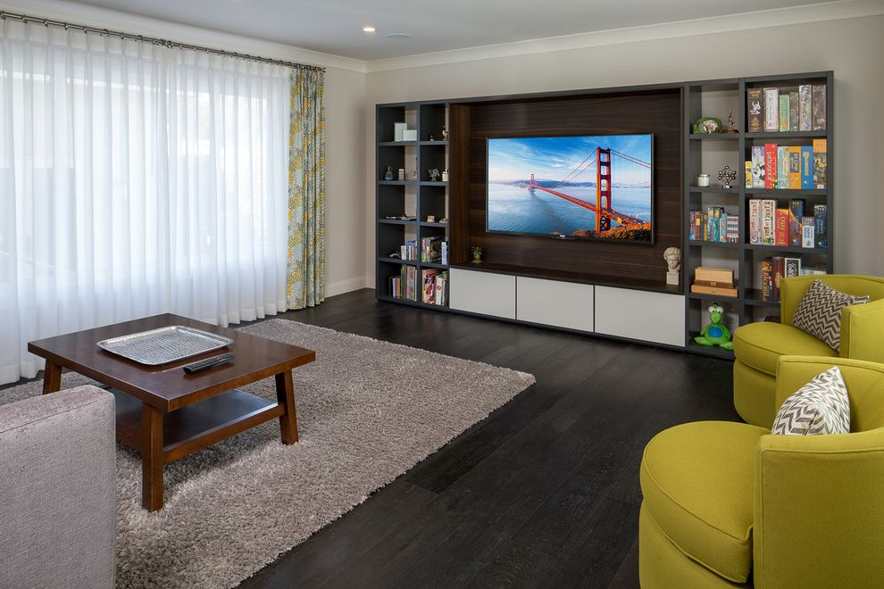 Gauthiers Rv Center   Contemporary Family Room  and Black Floor Entertainment Center Gray Rug Green Armchairs Open Shelves Sheer White Curtains Tan Area Rug Wood Coffee Table Wood Floors