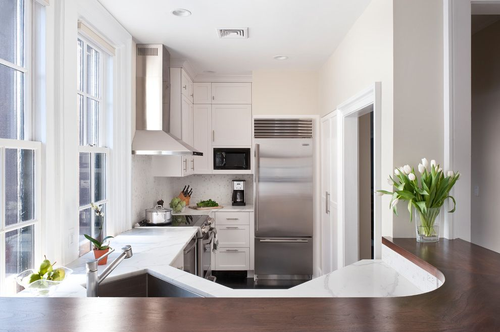 Ge Adora Refrigerator with Transitional Kitchen  and Backsplash Bosch Dishwasher Boston Curved Counter Elkay Sink High Cabinets Marble Counter Small Kitchen Stainless Steel Vent Hood Subzero Tulips White Cabinets Wood Counter