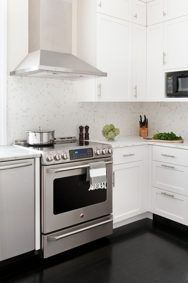 Ge Profile Spacemaker Over the Range Microwave   Transitional Kitchen Also Black Floor Black Floors Black Microwave Boston Bright Calcutta Clean Kitchen Ebony Floors Hardwood Floors Marble Backsplash Stainless Steel Hood White Cabinets White Kitchen