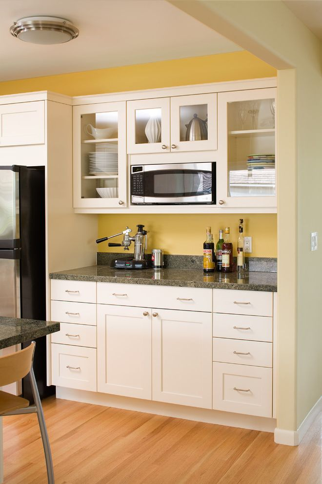 Ge Spacesaver Microwave with Contemporary Kitchen  and China Display Flush Mount Light Glass Front Cabinet Granite Counters Light Wood Floors Stainless Steel Appliances White Cabinets Yellow