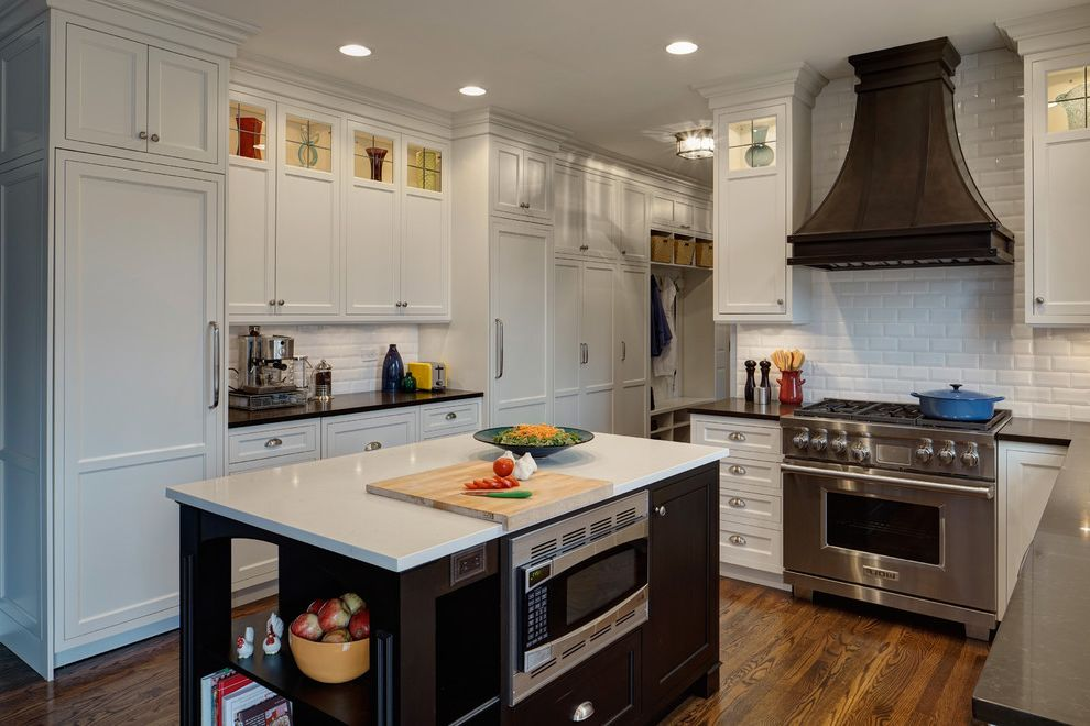 Ge Spacesaver Microwave with Traditional Kitchen Also Arched Valance Beveled Subway Tiles Hardwood Floors Kitchen Island Metal Hood Mud Room Open Shelf Range Hoods Recessed Lighting Stainless Sink Sub Zero White Countertop White Kitchen Wolf Range