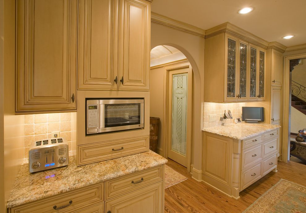 Ge Spacesaver Microwave with Traditional Kitchen  and Arch Doorway Barrel Ceiling Beige Cabinets Built in Microwave Frosted Glass Glass Cabinets Granite Countertops Kitchen Storage Kitchen Tv Molding Recessed Lighting Stainless Steel Wood Floor