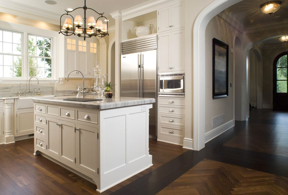 Ge Spacesaver Microwave with Traditional Kitchen  and Archway Baseboards Bin Pulls Chandelier Chevron Pattern Door Casing Footed Cabinets Island Lighting Kitchen Island Stainless Steel Appliances White Kitchen White Wood Wood Flooring Wood Molding