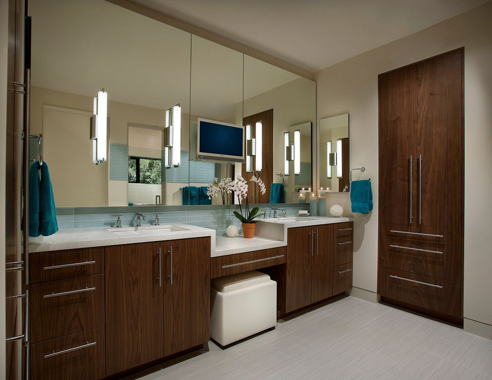 Georges Tool Rental with Southwestern Bathroom  and Blue Hand Towel Built in Storage Cabinet Recessed Medicine Cabinet Two Sinks Vanity Counter Wall Mounted Tv Wall Sconces White Countertop White Floor Tile White Stool White Walls