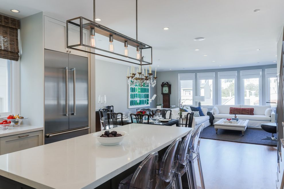 Ghost Counter Stool with Contemporary Kitchen  and Clear Bar Stools Freezer Drawer Grandfather Clock Kitchen Island Light Gray Walls Living Dining Kitchen Louis Ghost Stools Open Concept Recessed Lighting Rectangular Pendant White Countertop White Sofa
