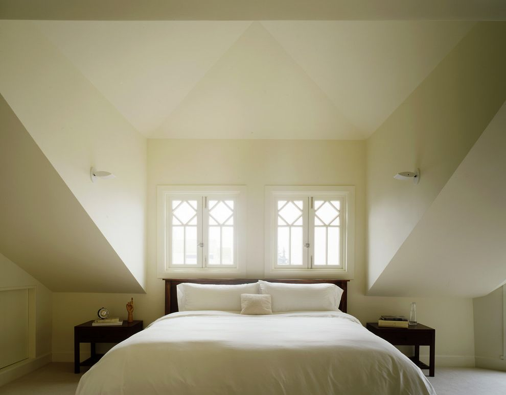 Gilkey Windows with Victorian Bedroom Also Alcove Bedside Table Dormer Windows Minimal Monochromatic Natural Light Neutral Colors Nightstand Nook Sconce Sloped Ceiling Symmetry Vaulted Ceiling Wall Lighting White White Bedding