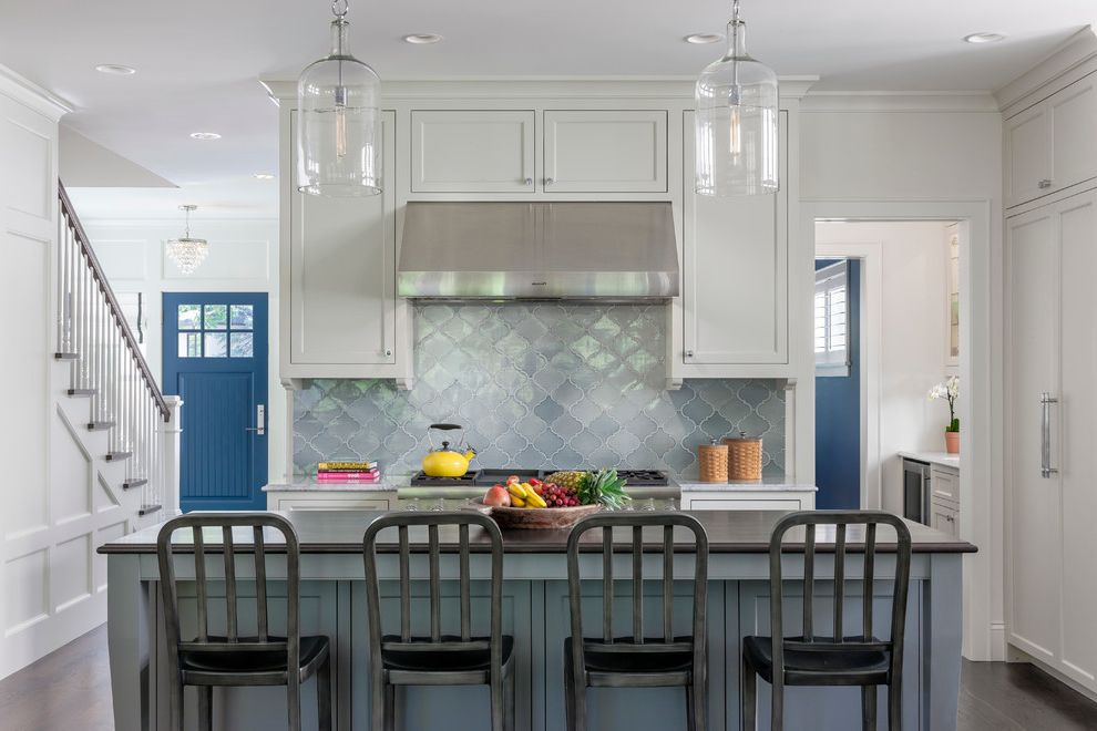 Glazzio Tiles with Traditional Kitchen  and Blue Door Counter Stools Island Pantry Pendant Lights Staircase Vent Hood