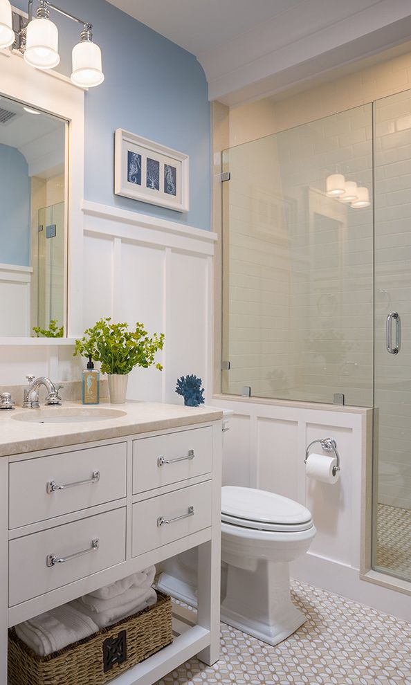 Glazzio Tiles with Victorian Bathroom Also Bathroom Lighting Blue Walls Board and Batten Coastal Crown Molding Frameless Shower Door Freestanding Vanity Mosaic Tile Floors Towel Storage Wainscoting White Cabinets White Trim Wicker Baskets