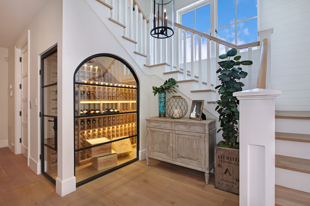 Global Wine Cellars   Beach Style Wine Cellar  and Chandelier Glass Door Glass Wall Interior Window Sideboard Staircase Steel Door Wine Cellar Under Stairs Wood Stair Treads