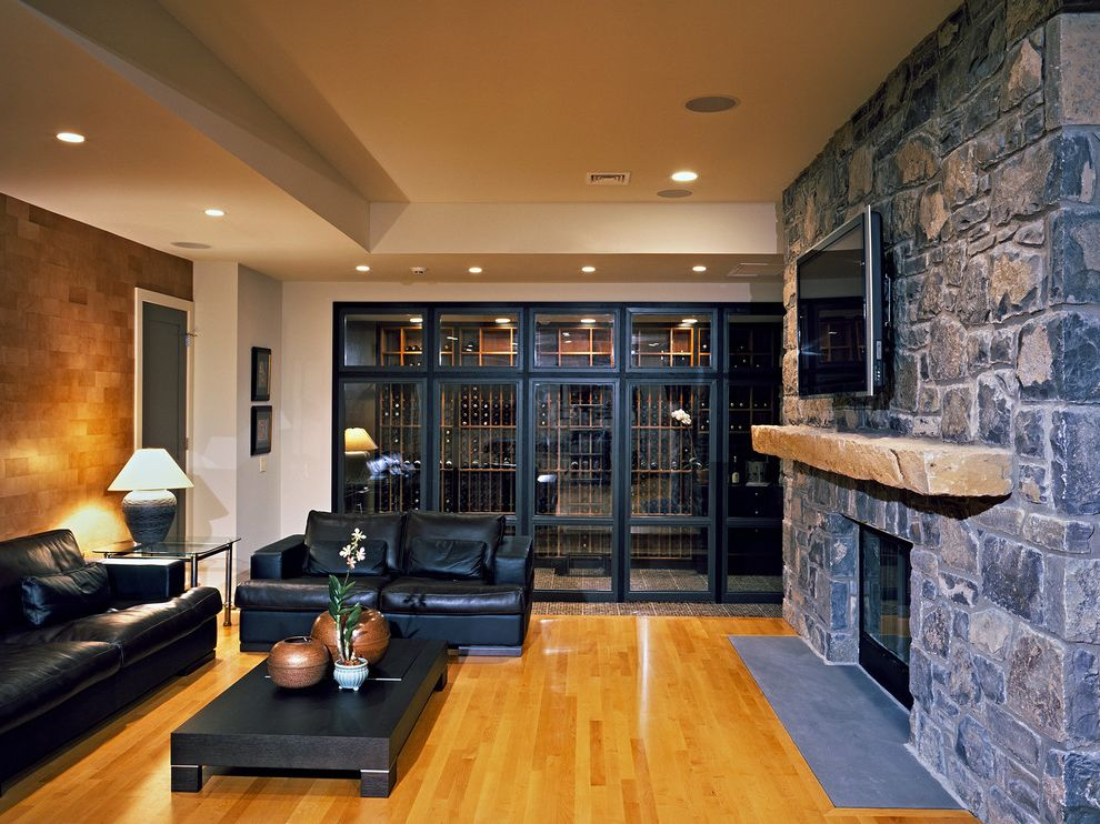 Global Wine Cellars   Contemporary Wine Cellar  and Black Leather Sofa Finished Basement Fireplace Leather Wall Tile Living Room Maple Flooring Media Room Stone Fireplace Tv Above Fireplace Wine Cellar Wood Flooring