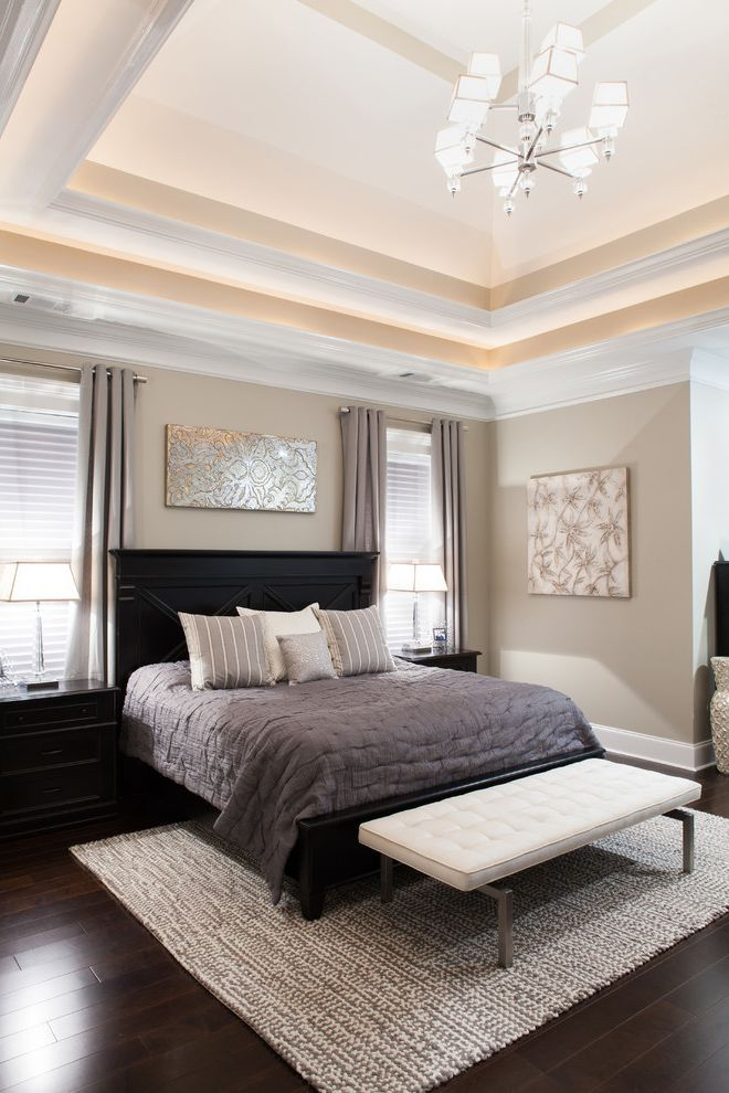 Go Pier1 Com   Transitional Bedroom Also Area Rug Art Above Bed Artwork Beige Walls Black Bed Frame Black Nightstands Chandelier Crown Molding Dark Wood Flooring End of Bed Bench Gray Curtains Neutral Bedding Striped Pillows Tray Ceiling White Bench