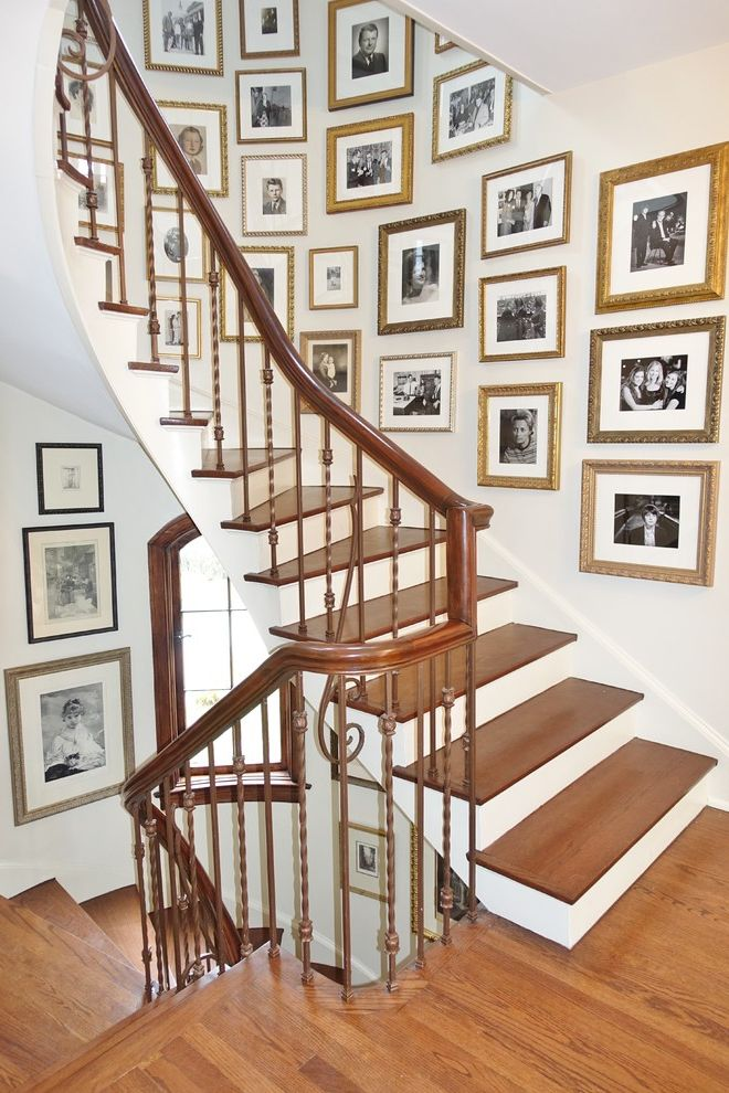 Gold Leaf Picture Frames with Traditional Staircase and Family Photos Natural Wood Picture Frames White Hallway White Stairwell